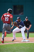 Columbus Clippers first baseman Jesus Aguilar (30) waits for a throw as Nick Williams (19) runs to first base during a game against the Lehigh Valley IronPigs on May 12, 2016 at Huntington Park in Columbus, Ohio.  Lehigh Valley defeated Columbus 2-1.  (Mike Janes/Four Seam Images)