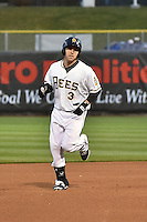 J.B. Shuck (3) of the Salt Lake Bees rounds the bases after hitting a home run against the Sacramento River Cats in Pacific Coast League action at Smith's Ballpark on April 3, 2014 in Salt Lake City, Utah.  (Stephen Smith/Four Seam Images)