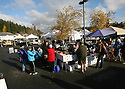 The Poulsbo Farmers Market is in its final weeks in downtown Poulsbo. The popular market extended its season into mid-december. Dozens of market shoppers came at the opening to gather fresh produce Saturday. Brad Camp | For the Kitsap Sun