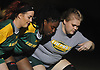 Abigail Timmins, left, works on scrum formations with Taylor Hill, center, and Kari Kyrkjeboe Fredheim during LIU Post women's rugby practice held on campus on Wednesday, Feb. 21, 2018.
