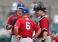 Norfolk Tides Starting Pitcher Jake Arrieta (34) talks with Coach Gary Allenson (6) and catcher Adam Donachie (right) during a game vs. the Rochester Red Wings at Frontier Field in Rochester, New York;  May 31, 2010.  Norfolk defeated Rochester by the score of 2-1.  Photo By Mike Janes/Four Seam Images