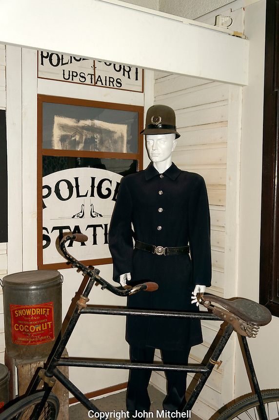 Old fashioned police constable with his bicycle, Vancouver Police Museum, Vancouver, BC, Canada
