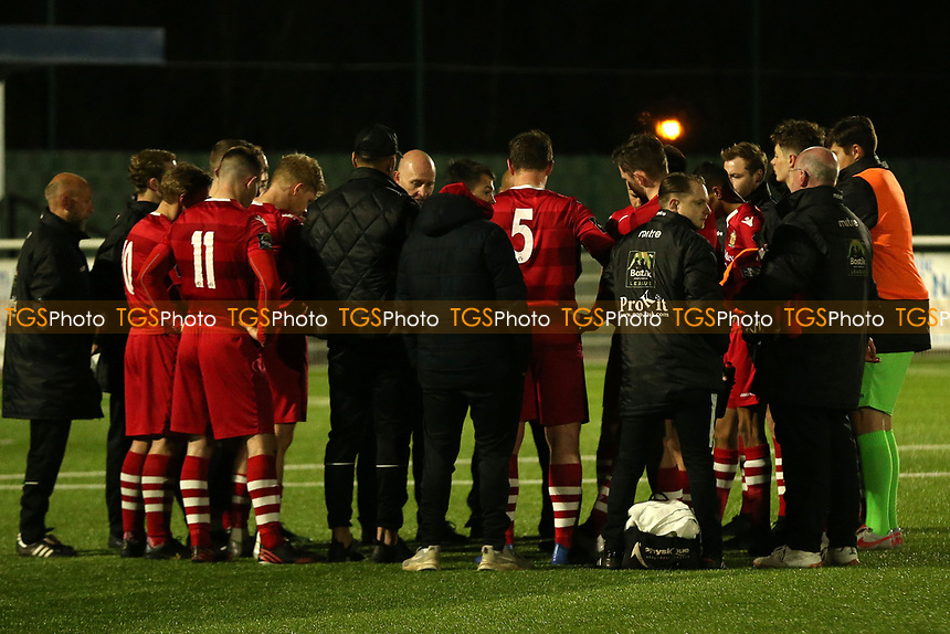 AFC Hornchurch players crowd around Manager Mark stimson after AFC Hornchurch vs Enfield Town, Velocity Trophy Final Football at Parkside on 10th April 2019