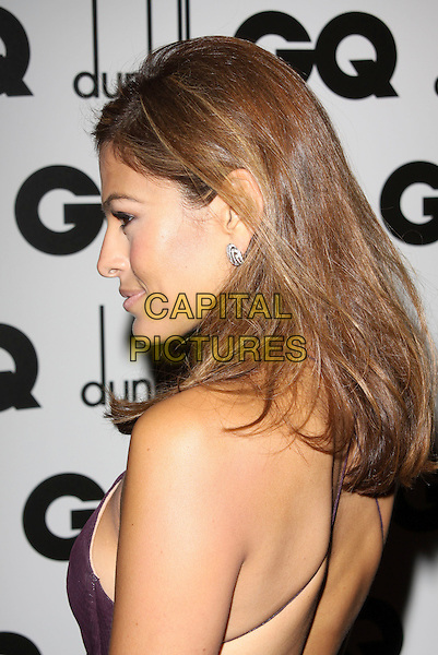 EVA MENDES .Attending the GQ Men Of The Year Awards 2009 held at the Royal Opera House, Covent Garden, London, England, UK, September 8th 2009. arrivals portrait headshot profile back side straps purple aubergine .CAP/AH.©Adam Houghton/Capital Pictures.