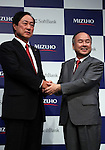 Japan's mega bank Mizuho Financial Group president Yasuhiro Sato (L) shakes hands with Japanese telecommunication giant Softbank president Masayoshi Son at a press conference in Tokyo on Thursday, September 15, 2016. They announced to form a FinTech based joint venture lending service.   (Photo by Yoshio Tsunoda/AFLO) LWX -ytd-