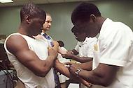 Fort Dix, NJ, USA, June 1980. Recruits receive several vaccinations.
