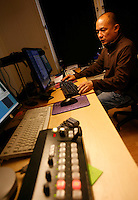Technician Nay Zaw Naing editing video footage. Democratic Voice of Burma is radio and TV station run by exiled Burmese. Opposing the government, the DVB has been transmitting, from the Norwegian capitol Oslo, into Burma since 1992.