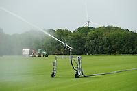 GERMANY, irrigation of rolling lawn field