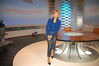 """LILLI GRUBER .Press conference for the new transmission of LA7 """"Otto e mezzo condotta"""" with Lilli Gruber and Federico Guiglia, Rome, Italy, September 2008..full length suit jacket blue sitting on table jeans .CAP/CAV.©Luca Cavallari/Capital Pictures"""