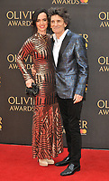 Sally Humphreys and Ronnie Wood at the Olivier Awards 2018, Royal Albert Hall, Kensington Gore, London, England, UK, on Sunday 08 April 2018.<br /> CAP/CAN<br /> &copy;CAN/Capital Pictures<br /> CAP/CAN<br /> &copy;CAN/Capital Pictures