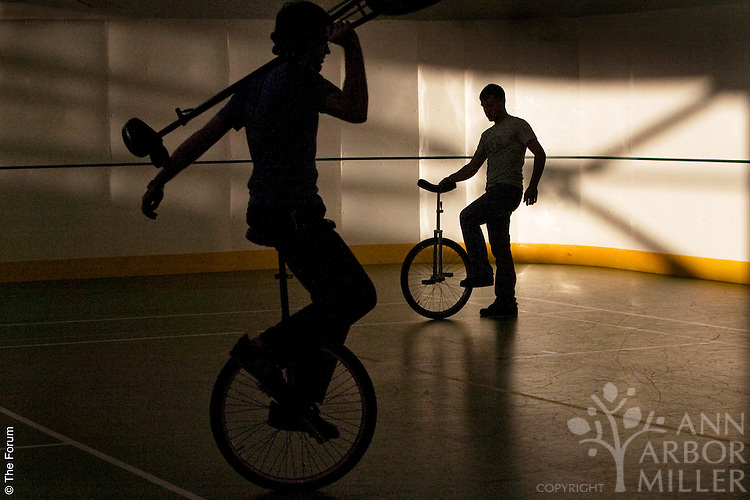 North Dakota State University students Paul Klapperich, left, and Travis Krueger take part in a meeting of the Nonchalant Unicycling and Tomfoolery Society (NUTS) at the Wallman Wellness Center on campus. The society, which is one of more than 200 student organizations at NDSU, is the first unicycling group in school history. NUTS has nine official members and meets regularly.