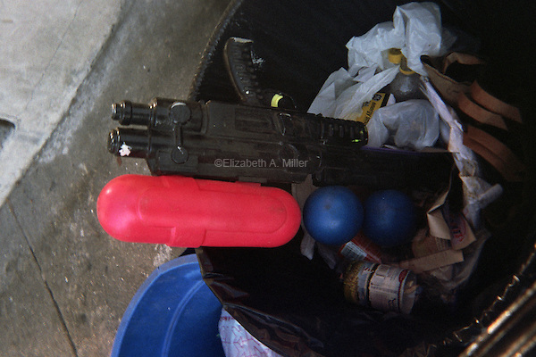 A watergun tossed in a trashcan along Washington Avenue.