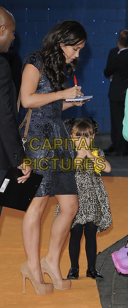 """Myleene Klass & Ava.""""The Lion King 3D"""" UK Premiere at BFI IMAX, Waterloo, London, England..September 25th 2011.full length black blue dress beige shoes red burgundy maroon bag purse side profile signing autographs kid child mother mom mum family brown leopard print dress .CAP/CAN.©Can Nguyen/Capital Pictures."""