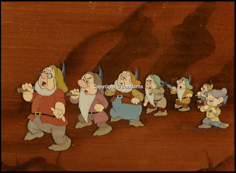 """BNPS.co.uk (01202 558833)<br /> Pic: Bonhams/BNPS<br /> <br /> A celluloid depicting the dwarfs during the """"Hi-Ho"""" scene sold for £4,374.<br /> <br /> The sale of original art work from Snow White has revealed that dwarfs dubiously named Tubby, Baldy and Deafy only just missed out on making the final cut.<br /> <br /> The offensively-named trio were considered by the famous producer of animated films in the run up to the classic 1937 movie.<br /> <br /> Now 32 pieces of Snow White art work, including sketches of the dwarfs which were withdrawn from production, have come to light to reveal the dubious names which would be considered very un-PC today."""
