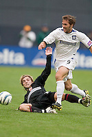 San Jose Earthquakes' Brian Mullan is tackled by D.C. United's Bobby Convey. DC United defeated the San Jose Earthquakes 2 to 1 during the MLS season opener at RFK Stadium, Washington, DC, on April 3, 2004.