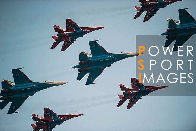 Sukhoi Su-27 of 'Russian Knights' and MIG-29 of 'Swifts' perform in a formation flying at the China International Aviation & Aerospace Exhibition (Airshow China 2016) at China International Aviation Exhibition Center on 02 November 2016, in Zhuhai, China. Photo by Marcio Machado / Power Sport Images