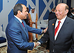 Egyptian President, Abdel Fattah al-Sisi, shakes hands with Abd Rabbo Mansour Hadi following the inauguration ceremony for the new additions to the Suez Canal, Egypt, 06 August 2015. The latest addition to the canal comes in at 35 kilometers of new canal and the widening of a further 37 kilometers of old canal, was completed in under a year, with an estimated cost of 8.5 billion US dollars once additional projects are completed, and was opened to shipping 06 August. According to the Egyptian Government the additional chanel cuts journey times from an estimated 18-14 hours to 11 hours, making it the fastest shipping lane of its kind worldwide, and will double revenue by 2023, though their figures have been widely disputed by international economists. Photo by Egyptian President Office