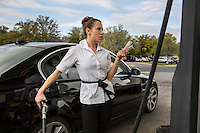 A female motorists grows frustrated as gas prices surge in Austin, Texas.