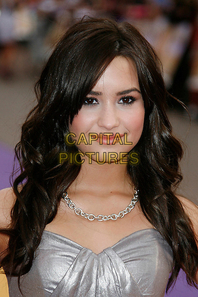 """DEMI LOVATO .Attending the UK Film Premiere of """"Hannah Montana: The Movie"""" at the Odeon cinema Leicester Square, London, England, UK, April 23rd 2009..portrait headshot  silver necklace .CAP/DAR.©Darwin/Capital Pictures"""