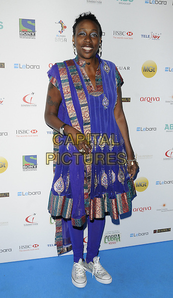 GINA YASHERE .the Lebara British Asian Sport Awards, Grosvenor House Hotel, Park Lane, London, England, Uk, March 5th 2011..full length blue patterned red gold green embroidered dress trainers leggings .CAP/CAN.©Can Nguyen/Capital Pictures.