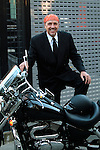 Businessman with bandana on his head with his motorcycle