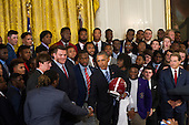United States President Barack Obama (right) is presented with an Alabama Crimson Tide team football jersey, a helmet and a football, during a ceremony to honor their 2015- 2016 College Football Playoff National Championship, in the East Room at The White House in Washington, D.C., Wednesday, March 2, 2016.<br /> Credit: Rod Lamkey Jr. / Pool via CNP