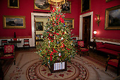 "The 2018 White House Christmas decorations, with the theme ""American Treasures"" which were personally selected by first lady Melania Trump, are previewed for the press in Washington, DC on Monday, November 26, 2018.  Pictured is a Christmas tree in the center of the Red Room  <br /> Credit: Ron Sachs / CNP"