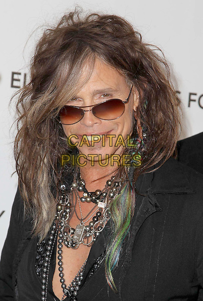 Steven Tyler (of Aerosmith).21st Annual Elton John Academy Awards Viewing Party held at West Hollywood Park, West Hollywood, California, USA..February 24th, 2013.oscars headshot portrait suit jacket necklace sunglasses shades .CAP/ADM/KB.©Kevan Brooks/AdMedia/Capital Pictures.