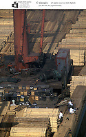 Wood and steel lay piled up on a dock in fuzhou, Fujian, china. China is increasingly importing more and more of the world's natural resources as it continues to grow at an astranomical pace..11 Nov 2004