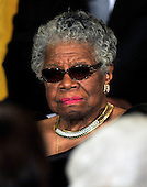"""Celebrated author and poet Maya Angelou listens as United States President Barack Obama and first lady Michelle Obama honor her and the other recipients of the 2010 Medal of Freedom, """"the Nation's highest civilian honor presented to individuals who have made especially meritorious contributions to the security or national interests of the United States, to world peace, or to cultural or other significant public or private endeavors"""", in a ceremony in the East Room of the White House in Washington, D.C. on Tuesday, February 15, 2011..Credit: Ron Sachs / CNP"""