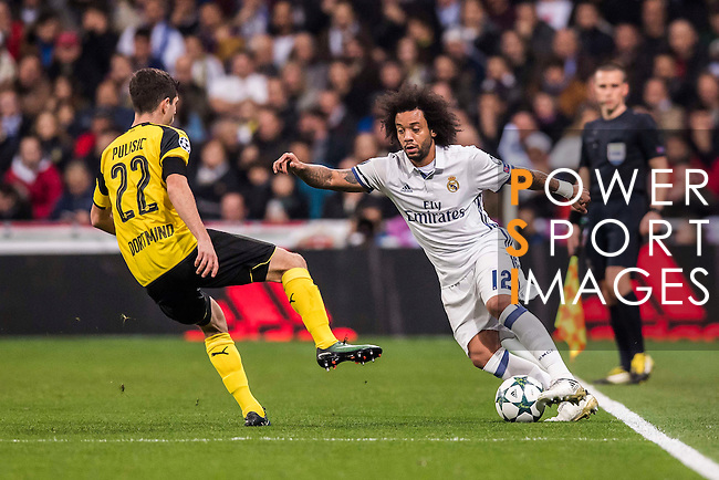 Marcelo Vieira Da Silva of Real Madrid battles for the ball with Christian Pulistic of Borussia Dortmund during the 2016-17 UEFA Champions League match between Real Madrid and Borussia Dortmund at the Santiago Bernabeu Stadium on 07 December 2016 in Madrid, Spain. Photo by Diego Gonzalez Souto / Power Sport Images