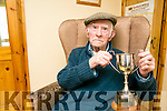 92 year-old Eddie Boyle, holding the Patrick Rohan Memorial Cup,  the last living player from the 1943 final, last time the final was played in Clahane over 70 years ago