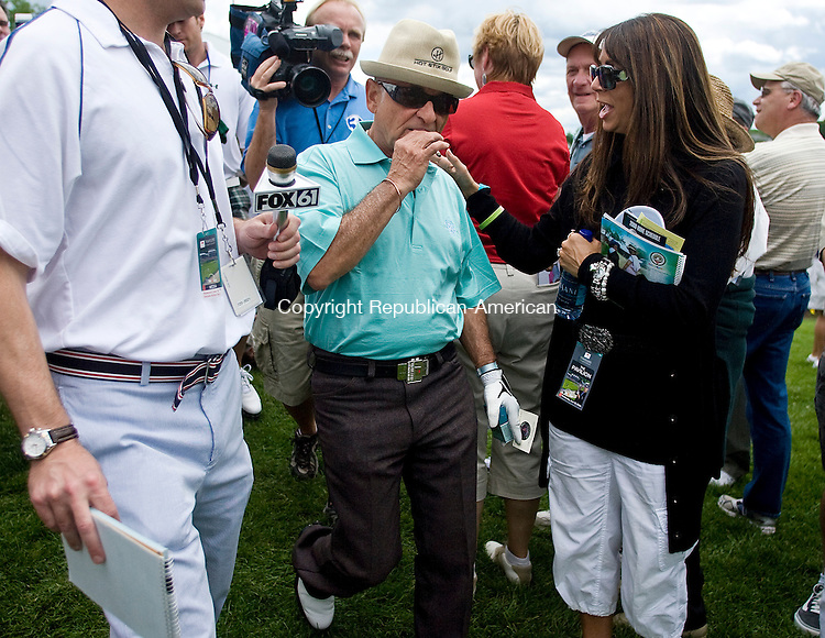 CROMWELL--18 June 08--061808TJ14 - Actor Joe Pesci makes his way through the crowd to the first tee to start the PGA Tour Travelers Championship Pro-Am at TPC River Highlands in Cromwell on Wednesday, June 18, 2008. (T.J. Kirkpatrick/Republican-American)
