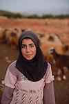 LEBANON Deir el Ahmad, a maronite christian village in Beqaa valley, syrian refugee camp / LIBANON Deir el Ahmad, ein christlich maronitisches Dorf in der Bekaa Ebene, Camp fuer syrische Fluechtlinge, Familie Bassimeh Al Rifai, die Tochter Roya Nayef (im Bild) geht zur Schule der Good Shepherd sisters, hütet Tierherde