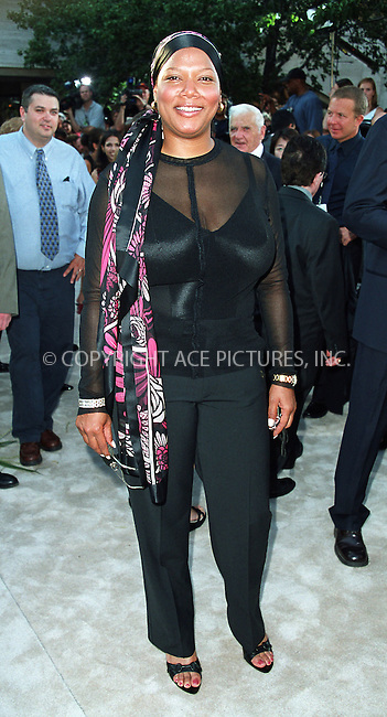 "Queen Latifah arrives at the world premiere of Touchstone Pictures' movie, ""Signs"" at Lincoln Center, New York. July 29, 2002. Please byline: Alecsey Boldeskul/NY Photo Press.   ..*PAY-PER-USE*      ....NY Photo Press:  ..phone (646) 267-6913;   ..e-mail: info@nyphotopress.com"