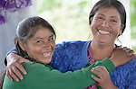 Maria Lucia Ventura (left)  hugs another woman during a workshop at an eco-agricultural training center in Comitancillo, Guatemala. The center is sponsored by the Maya Mam Association for Investigation and Development (AMMID).
