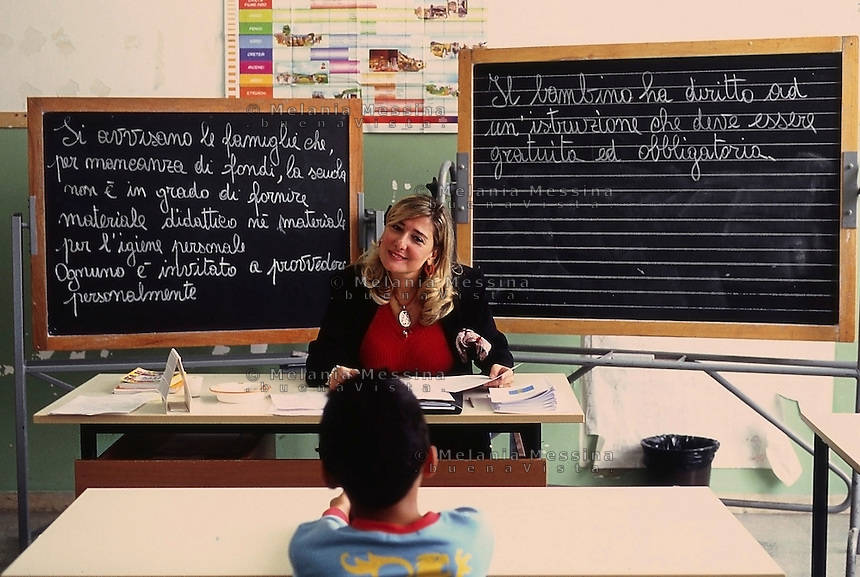 A teacher in a primary pubblic school in Palermo does her work as good as she can in a  very disadvantaged neighborood, where families don't send kids to study and everything  became more difficult due to the recent govenment cuts to public school.<br />