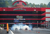 Jun. 18, 2011; Bristol, TN, USA: NHRA pro mod driver Dennis Radford (right) does a burnout alongside Danny Rowe during qualifying for the Thunder Valley Nationals at Bristol Dragway. Mandatory Credit: Mark J. Rebilas-