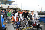 People exiting the ferry boat over the Ij River to the Film Museum, Amsterdam, Netherlands.