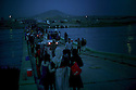 Iraq 2014  <br /> August 10, Yezidis  crossing the bridge of Pesh Kabur by night  <br /> Irak  2014  <br /> Yezidis traversant la nuit le pont de Pesh Kabour. Sur la rive irakienne, des vehicules vont les transporter vers un camp de transition.