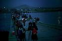 Iraq 2014  <br /> August 10, Yezidis  crossing the bridge of Pesh Kabur by night  <br /> Irak  2014  <br /> Yezidis traversant la nuit le pont de Pesh Kabour. Sur la rive irakienne, des vehicules vont les transporter vers un camp de transition.
