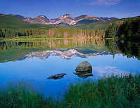 Rocky Mountain National Park, CO<br /> Morning light on Otis Peak, Hallett Peak, and Flattop Mountain with  reflections on Sprague Lake