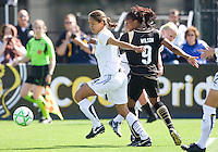 24 May 2009: Stephanie Cox of the Los Angeles Sol dribbles the ball away from FC Gold Pride defender at Buck Shaw Stadium in Santa Clara, California.  Los Angeles Sol defeated FC Gold Pride, 2-0.