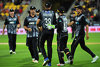 The Black Caps congratulate Tim Southee for catching Jos Buttler during the International Twenty20 cricket match between the NZ Black Caps and England at Westpac Stadium in Wellington, New Zealand on Tuesday, 13 February 2018. Photo: Dave Lintott / lintottphoto.co.nz