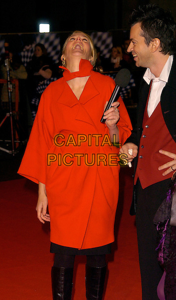"EDITH BOWMAN.""The Prestige"" UK film premiere.Odeon West End cinema, Leicester Square.5th November 2006 London, England.Ref: CAN.half length red coat head back laughing microphone funny.www.capitalpictures.com.sales@capitalpictures.com.©Phil Loftus/Capital Pictures"