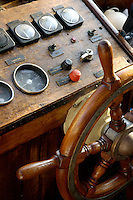 Controls and steering wheel of a dive boat.