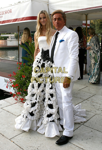"VALENTINO GARAVANI & MODEL.The premiere of the film ""The Devil Wears Prada"" during the ninth day of the 63rd Venice Film Festival in Venice, Italy. .September 7, 2006.Ref: CAT.full length white suit designer black ruffles gathered dress gown.www.capitalpictures.com.sales@capitalpictures.com.©Cat/Capital Pictures."