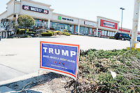 A campaign sign for Republican presidential candidate Donald Trump is seen near the Airport Plaza strip mall in Warwick, Rhode Island, USA, on Sun., Apr. 24, 2016. The campaigns of Trump, Kasich, and Cruz, have set up their state operations in offices at Airport Plaza.