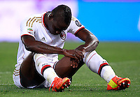 Calcio, Serie A: Roma vs Milan. Roma, stadio Olimpico, 25 aprile 2014.<br /> AC Milan forward Mario Balotelli reacts during the Italian Serie A football match between AS Roma and AC Milan at Rome's Olympic stadium, 25 April 2014.<br /> UPDATE IMAGES PRESS/Isabella Bonotto