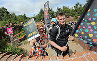 Pictured: Maria Golightly (L) by the mythical beast sculpture by artist Gwen Heeney Saturday 13 August 2016<br />Re: Grow Wild event at  Furnace to Flowers site in Ebbw Vale, Wales, UK